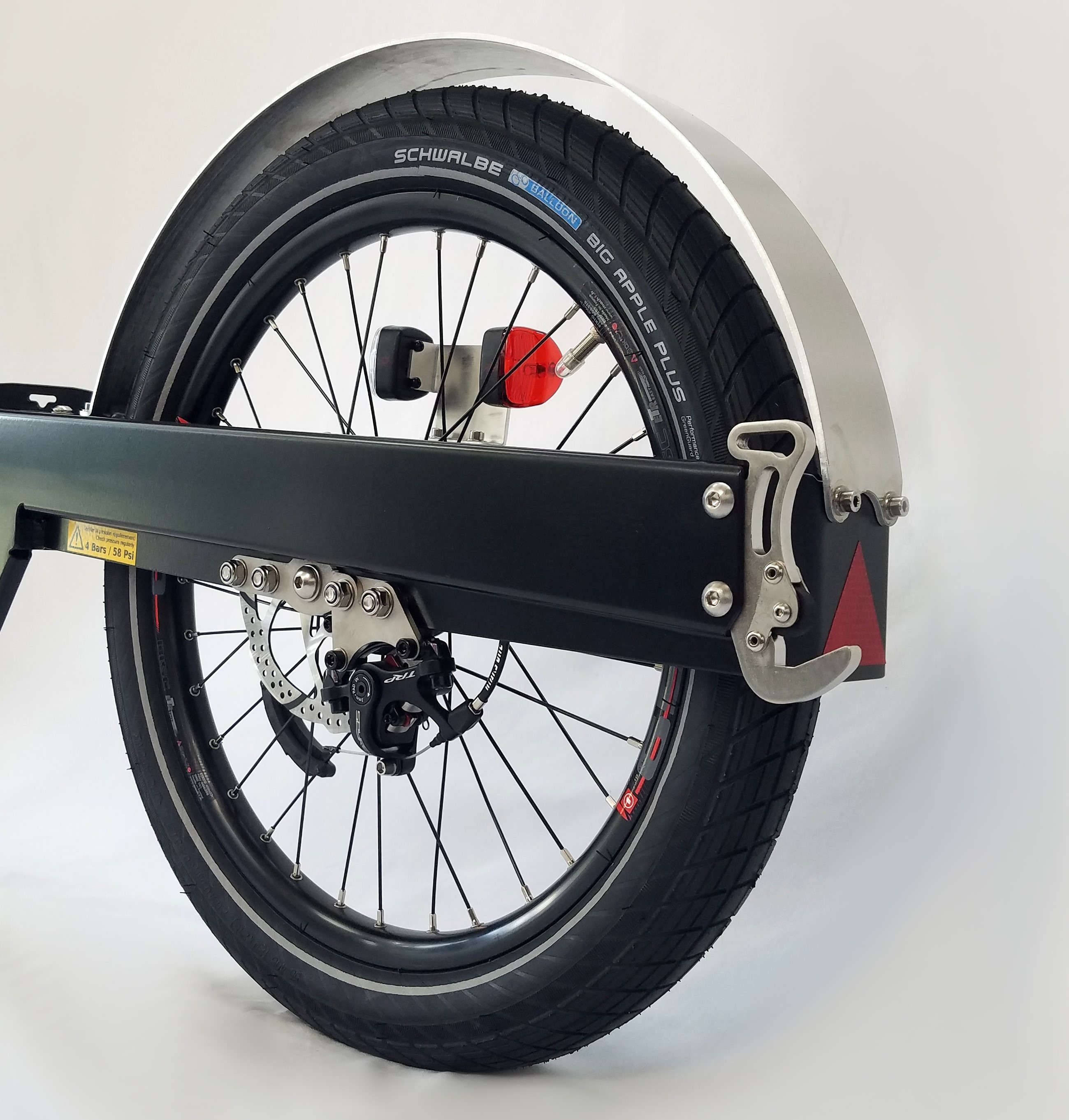 Part of a bike trailer with wheel, disc brake, hook, mudguard and a red and white light