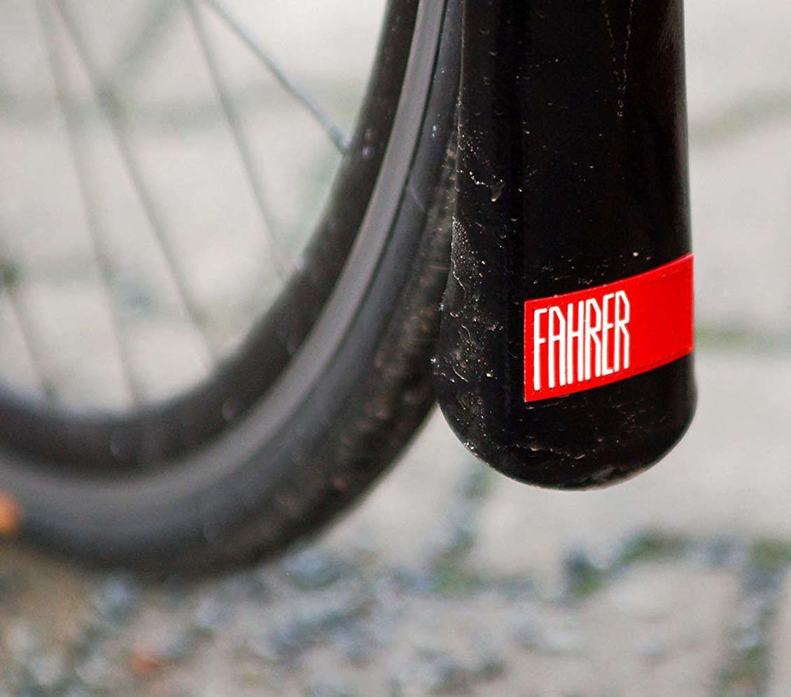 Bike wheel with a black mudguard withe a red part and fahrer written in white on it
